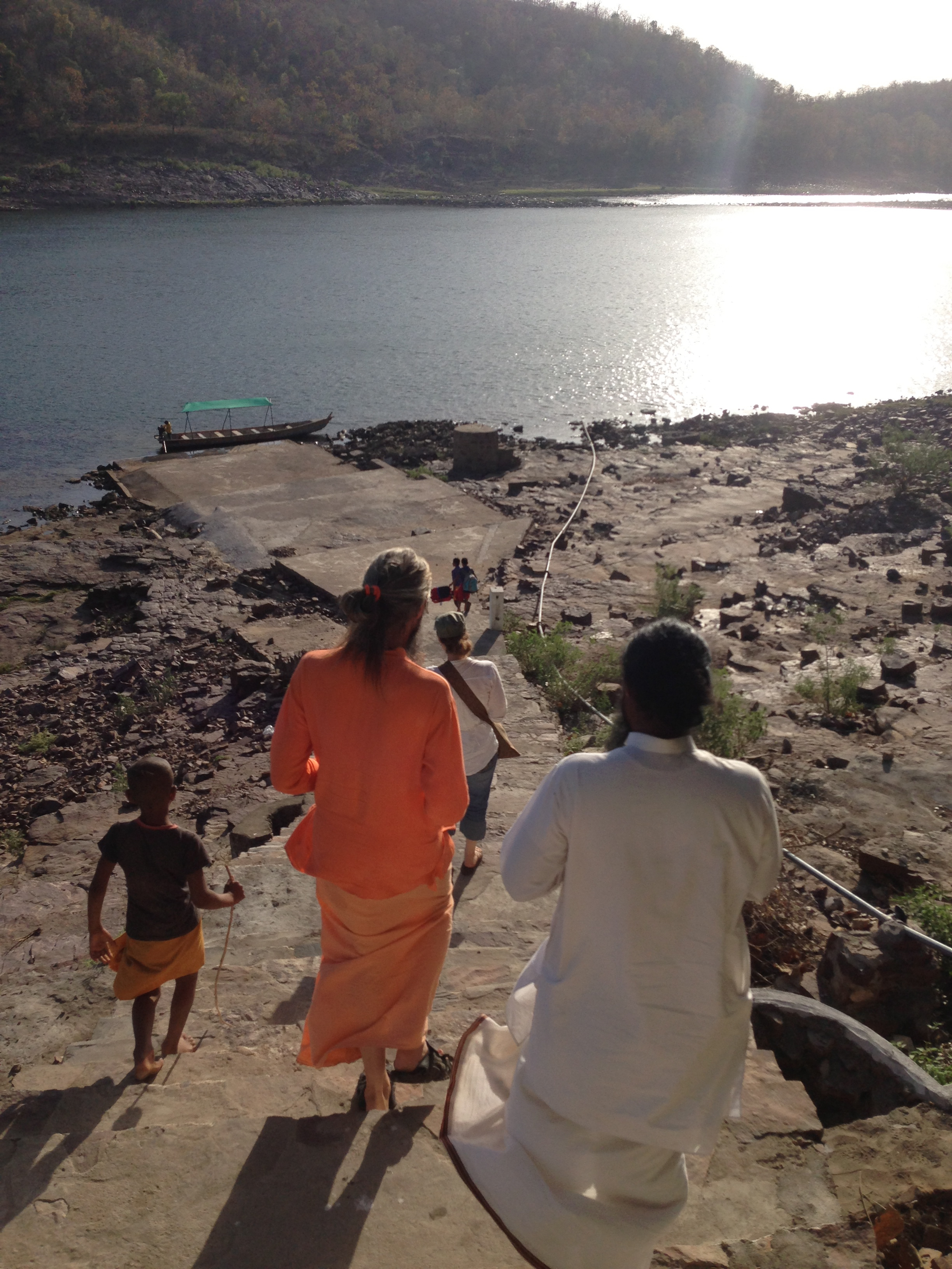 Walking down the ashram steps to our boat…driven by kids!